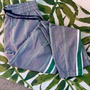High waisted pair of plaid joggers